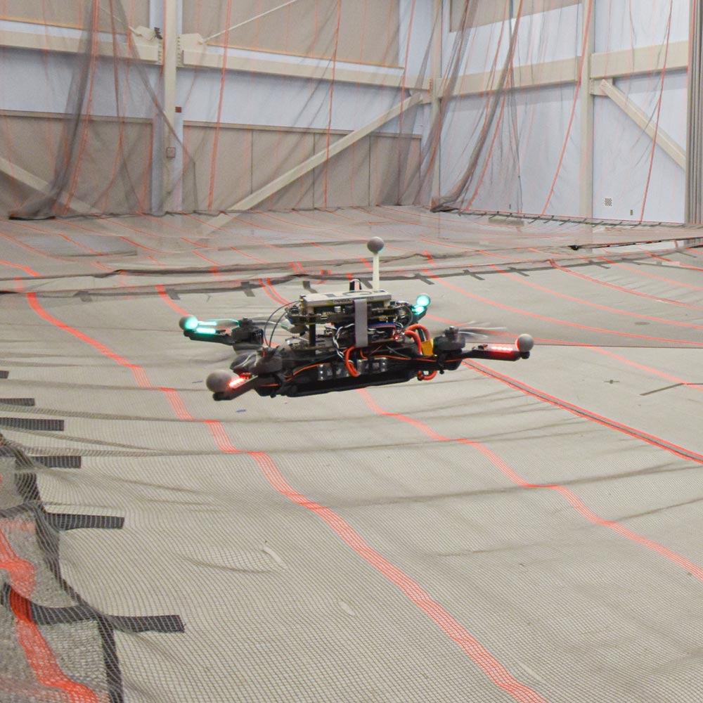 Image of a drone flying inside an indoor lab at MIT.